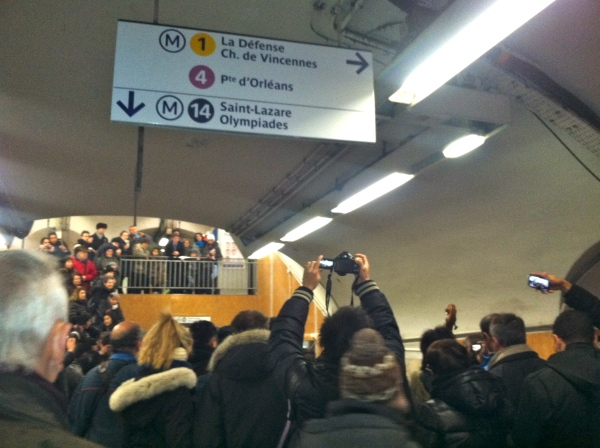 People at the Metro Station excited to listen to a group of classical musicians.