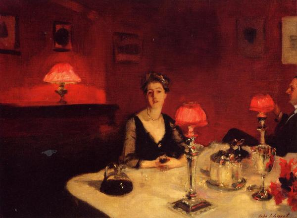a-dinner-table-at-night-1884